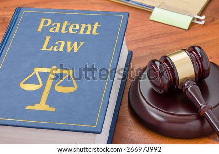 A law book with a gavel - Patent law - stock photo