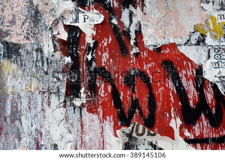 a layered graffiti and torn poster background - stock photo