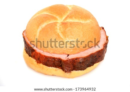 A Leberkaese roll is a typical bavarian breakfast - stock photo