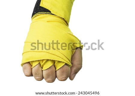 A left hand wrapped in a yellow boxing wrap isolated on a white background. - stock photo