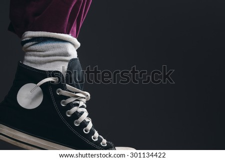 a Leg with Pants, Socks and Sneakers - stock photo