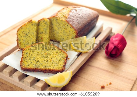 A Lemon Poppy Seed Bread served in slices. Shallow depth of field on the front slice