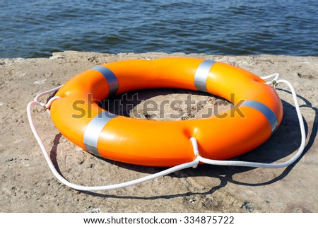 A life buoy on the wharf - stock photo