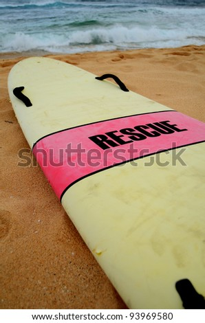 A Lifeguard's Rescue Surfboard On A Hawaiian Beach On A Stormy Day - stock photo