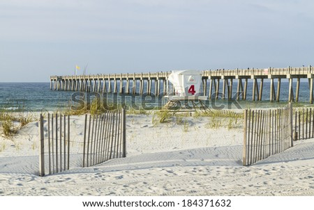 A lifeguard station in the dunes, and the fishing pier in the early morning on Pensacola Beach, Florida.