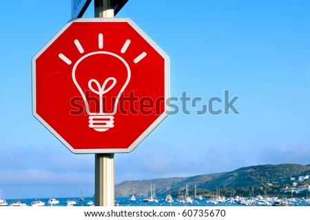 a light bulb drawn in a traffic sign symbolizing concept idea - stock photo