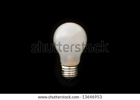 A light bulb on a black background