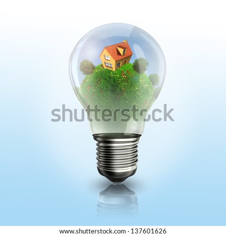 A light bulb with house and garden inside