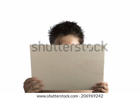 A light color plywood square blank signboard supported by young hands on light isolated background: the face of the boy is covered to keep the main focus of the viewer on the contents of the sign. - stock photo