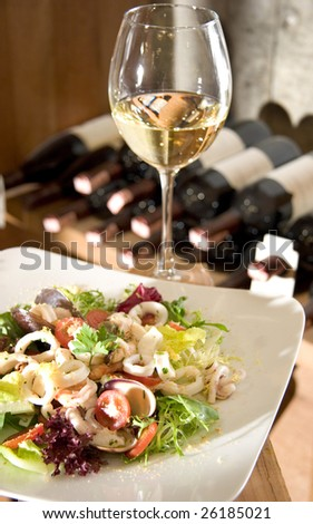a light dinner with wine in cellar - stock photo