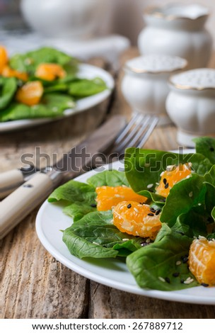a light salad of spinach and Mandarin oranges with lemon dressin