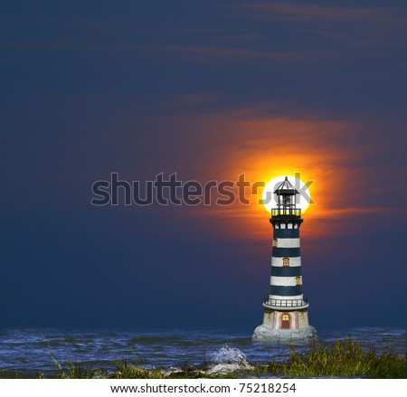 A lighthouse in the bay with the sun on fire through the clouds in the background as it is setting over the horizon. - stock photo