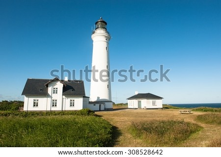 A lighthouse nearby Hirtshals city in Denmark  - stock photo