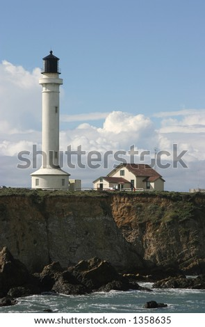 A lighthouse on the rugged cliffs of Point Arena, California.