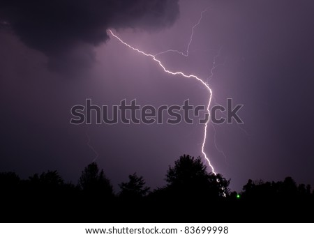 A lightning strike seeks out it target a few milliseconds after leaving the cloud. Picture was taken on August 29, 2011. - stock photo