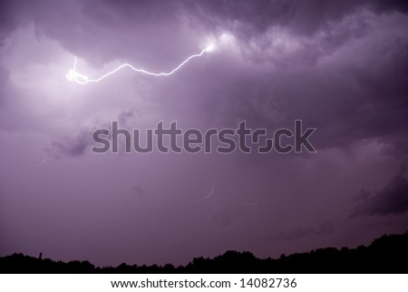 A lightning with stormy clouds and some rain.