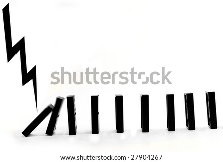 A line of black dominoes falling down, isolated on a white background with a narrow depth of field. - stock photo