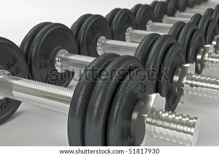 A line of dumbbells with shallow depth of field - stock photo