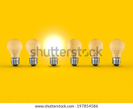 A line of lightbulbs with only one lit - stock photo