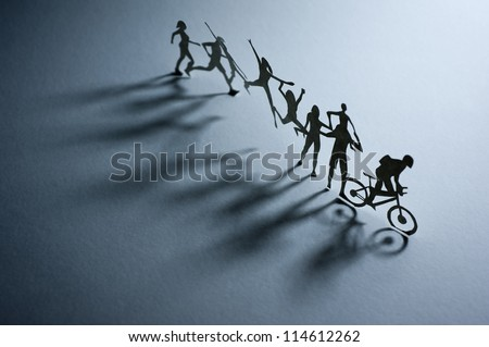 A Line of Paper People - Macro photography - stock photo
