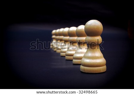 A line of pawns - stock photo