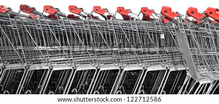 A line of shopping carts nested together - stock photo
