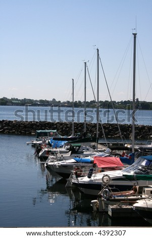 A line of summer boats in the harbor off the St Lawrence River in Canada. - stock photo