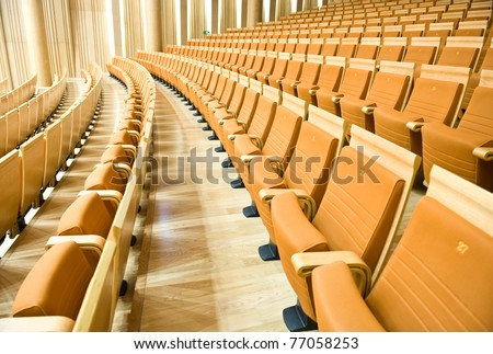 A line of theater chairs. - stock photo