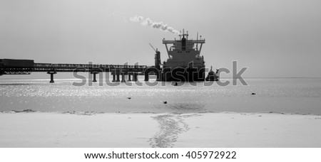 A liquefied gas carrier loaded at the dock - stock photo