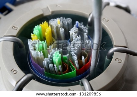 A Liquid Nitrogen bank showing a full goblet of straws used for impregnating cows. - stock photo