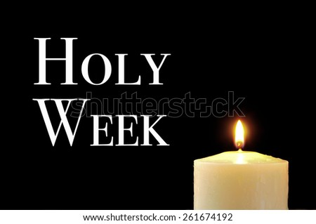 a lit candle and the text holy week written in white on a black background - stock photo