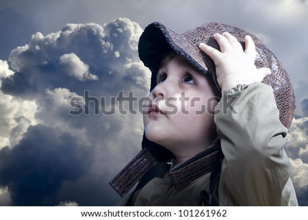 A little baby boy dreams of becoming a pilot. Vintage aviation hat. - stock photo