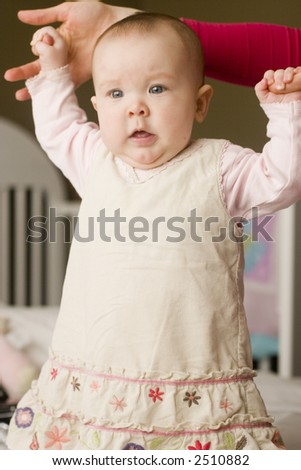 a little baby holding mothers hands - stock photo
