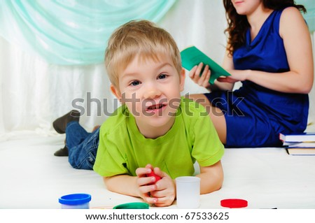 A little boy and his mom are having fun together.