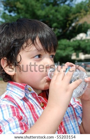 A little boy getting hydrated - stock photo