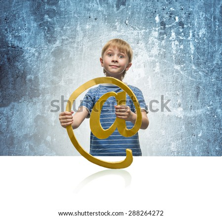 A little boy holding a sign of email - stock photo