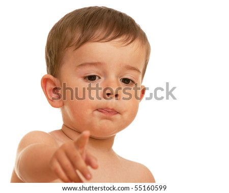 A little boy is pointing forward; isolated on the white background