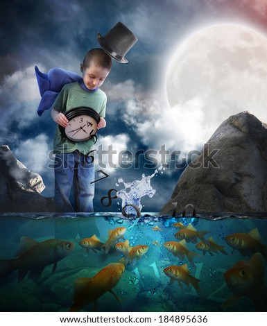 A little boy is standing in the night water pouring time out of a clock with goldfish looking at the numbers for a bedtime or story concept. - stock photo