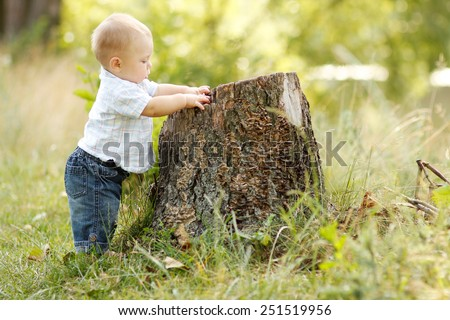a little boy playing in nature - stock photo