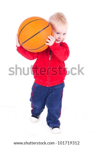 A little boy playing with a basketball. Studio shot on a white background. - stock photo