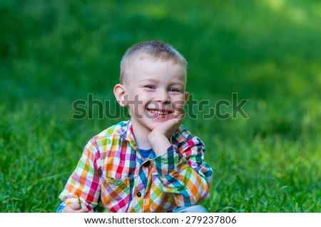 A little boy smiling and hand supports the head. Family composition - stock photo