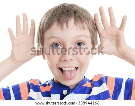 A Little boy wincing on white background - stock photo