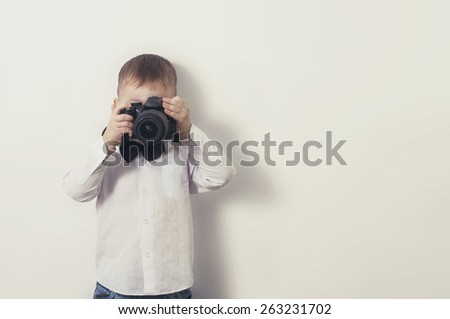 a little boy with a camera - stock photo