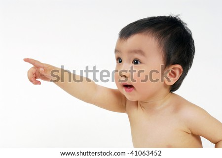 A little Chinese infant baby boy one arm outstretched is pointing his finger