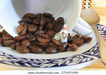 A little cook is brewing coffee. - stock photo