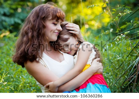 a little girl asleep in the arms of mother