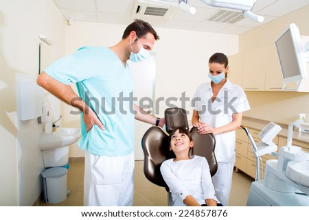 A little girl at the dentist before treatment. - stock photo