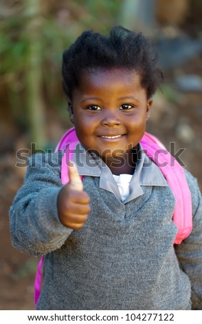 A little girl back from school after her first day. - stock photo