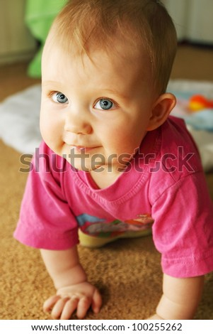 a little girl crawling on all fours - stock photo