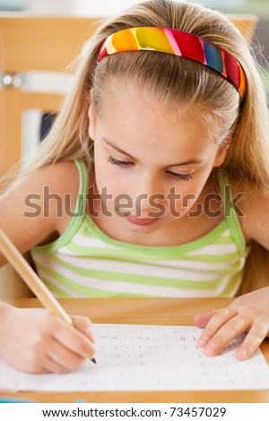a little girl doing her math problems - stock photo